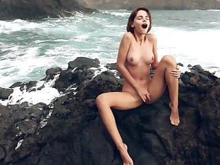 Majestic outdoor masturbation regarding Ariela, as waves crash in the steed