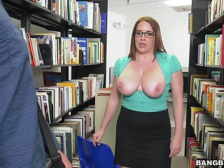Busty adult Maggie Green drops on her knees to give a blowjob