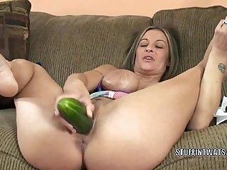 Busty cougar Leeanna Main ingredient masturbates in the air a cucumber
