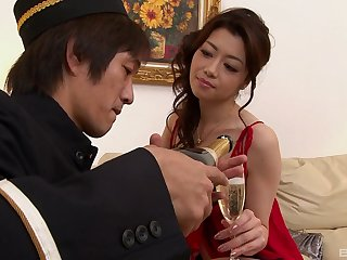 Asian seductress seduces a hotel employee into creampieing her pussy