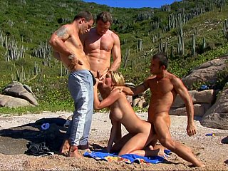 Outdoors gang-bang for a blonde