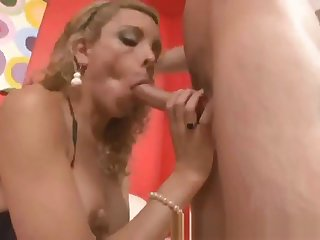 Blonde shemale spoil sucks and tugs a hard cock