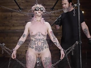 Submissive babe clamped by the clit with an increment of brutally fucked